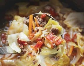 unstuffed cabbage soup in an instant pot with a ladle