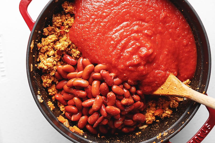 ingredients for turkey chili in a red pot
