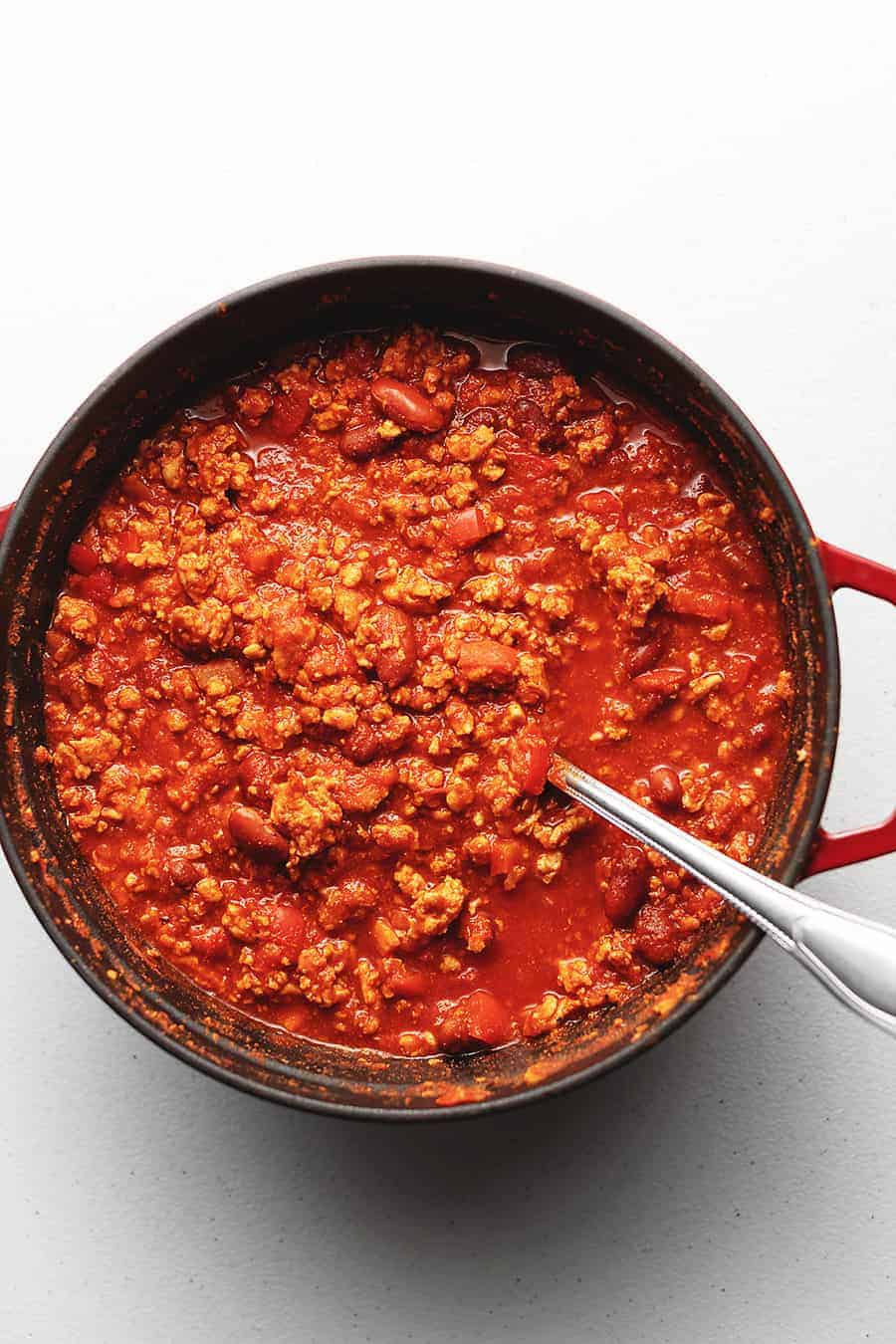 healthy turkey chili in a red dutch oven