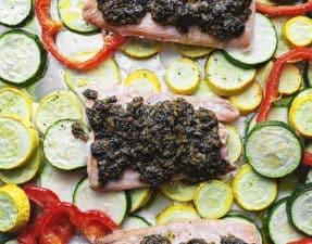 pesto salmon with veggies on a sheet pan