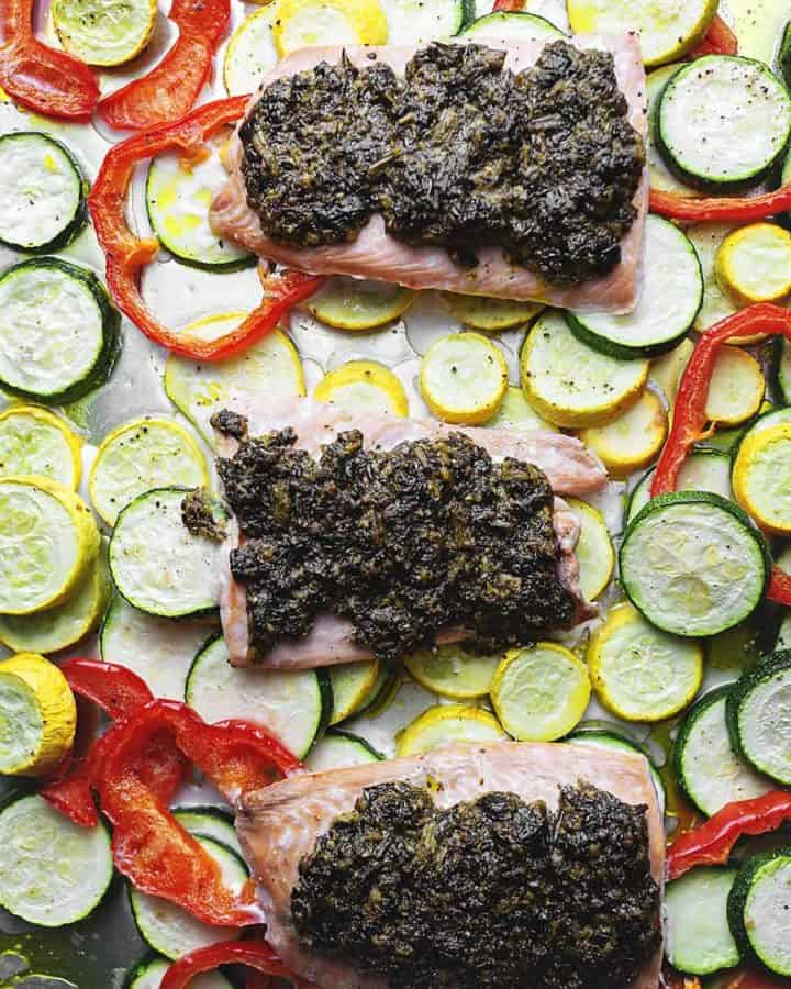 pesto salmon with veggies on a sheet pan