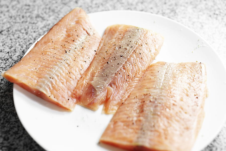 salmon filets on a white plate