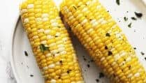 oven roasted corn on the Cobb on a white plate
