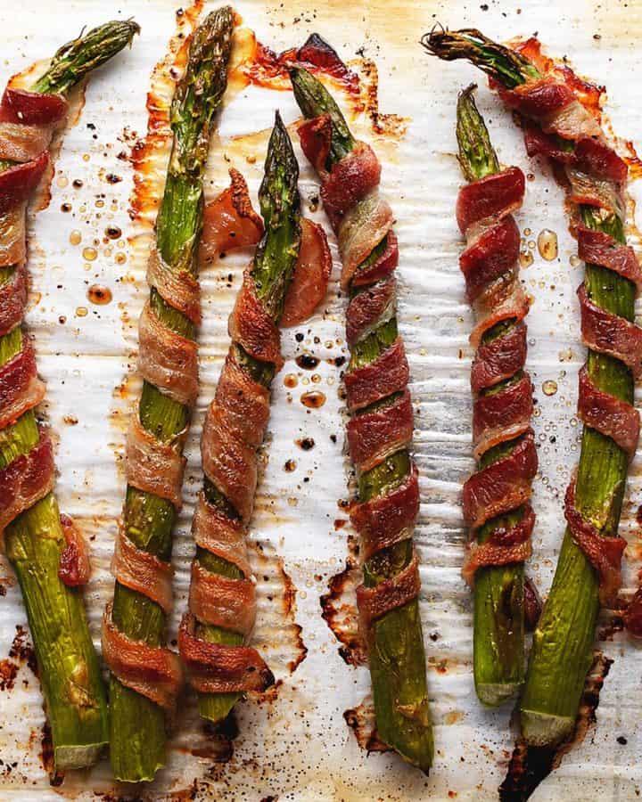 crispy bacon wrapped asparagus on parchment paper