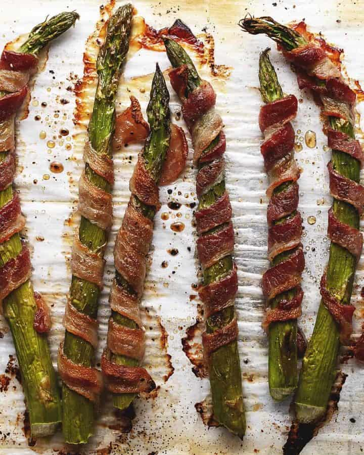 bacon wrapped asparagus with brown sugar on a sheet pan