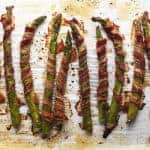 bacon wrapped asparagus on a sheet pan