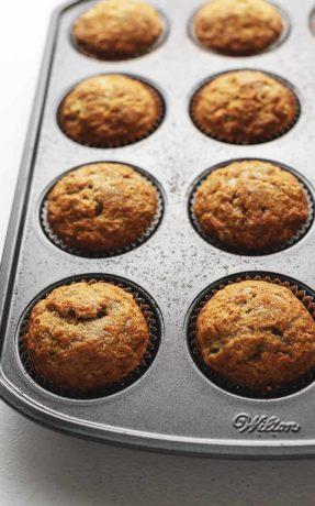 banana bread muffins in a muffin tin