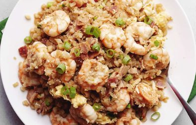 cauliflower fried rice with shrimp on a white plate