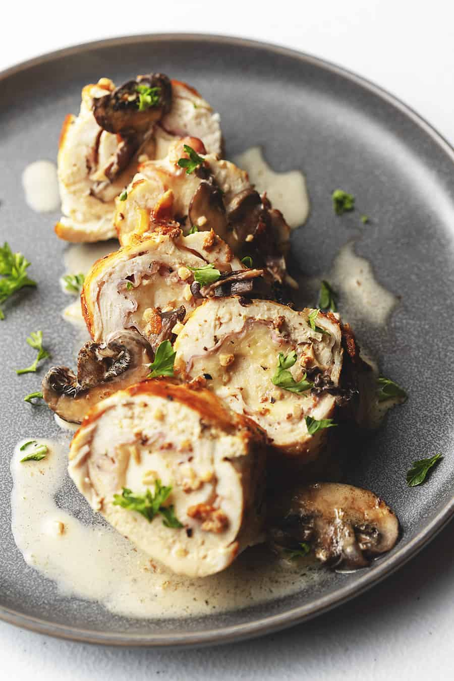 chicken rolls on a gray plate