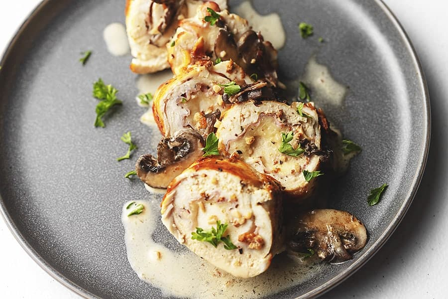 sliced chicken rollitini on a plate