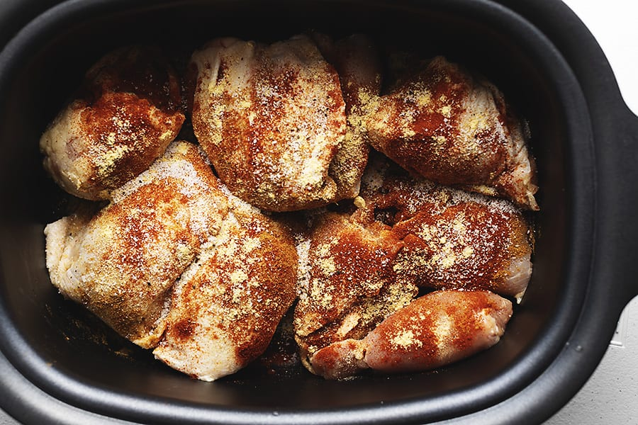 bbq chicken thighs with spices in a crockpot