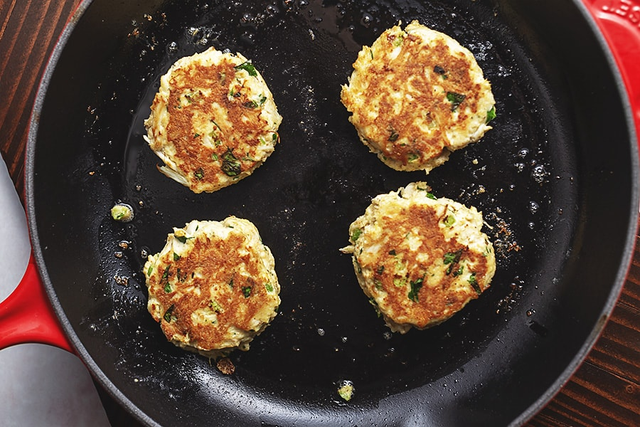 keto crab cakes cooking in a skillet