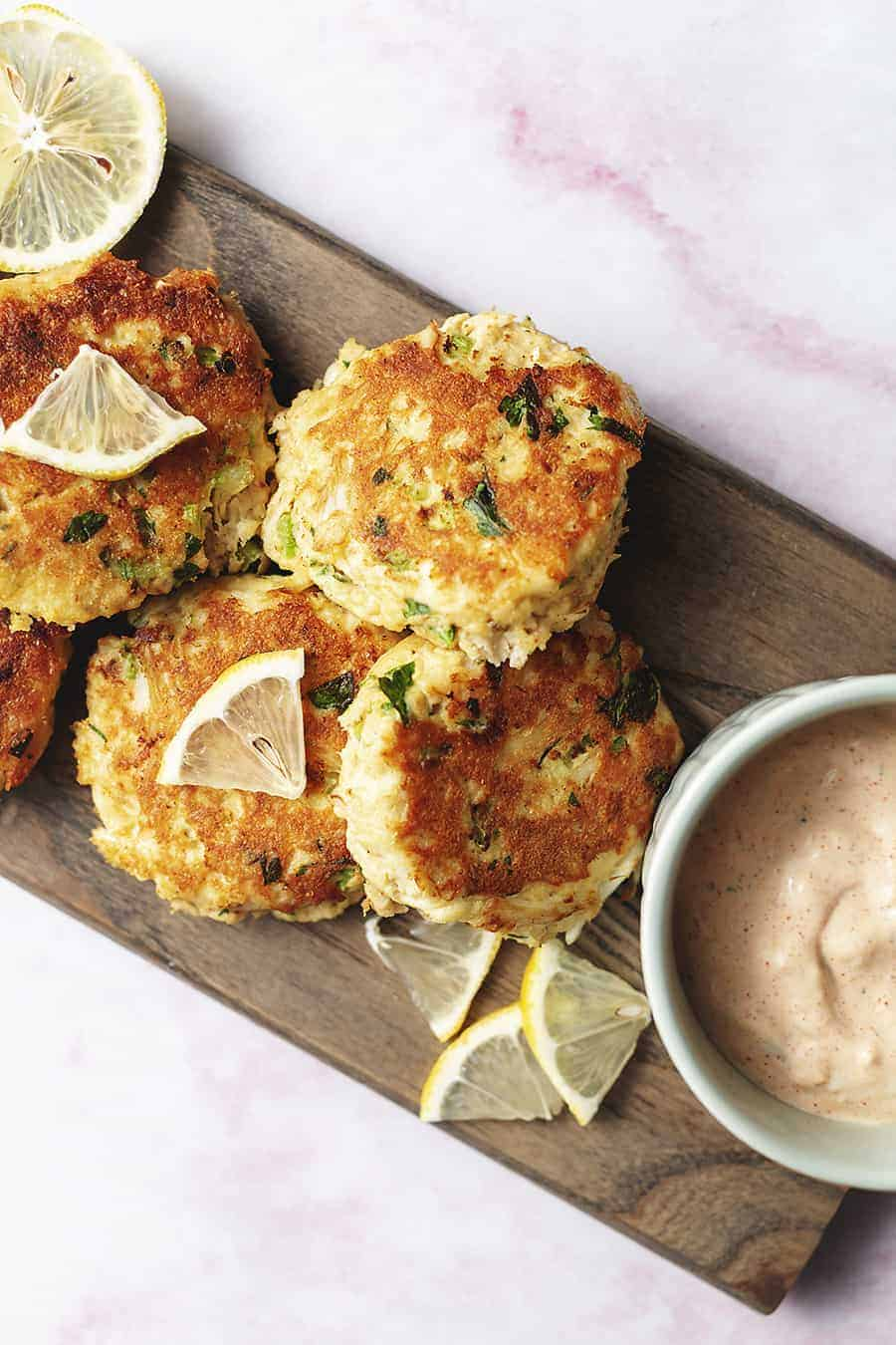 keto crab cakes on a wood board with remoulade