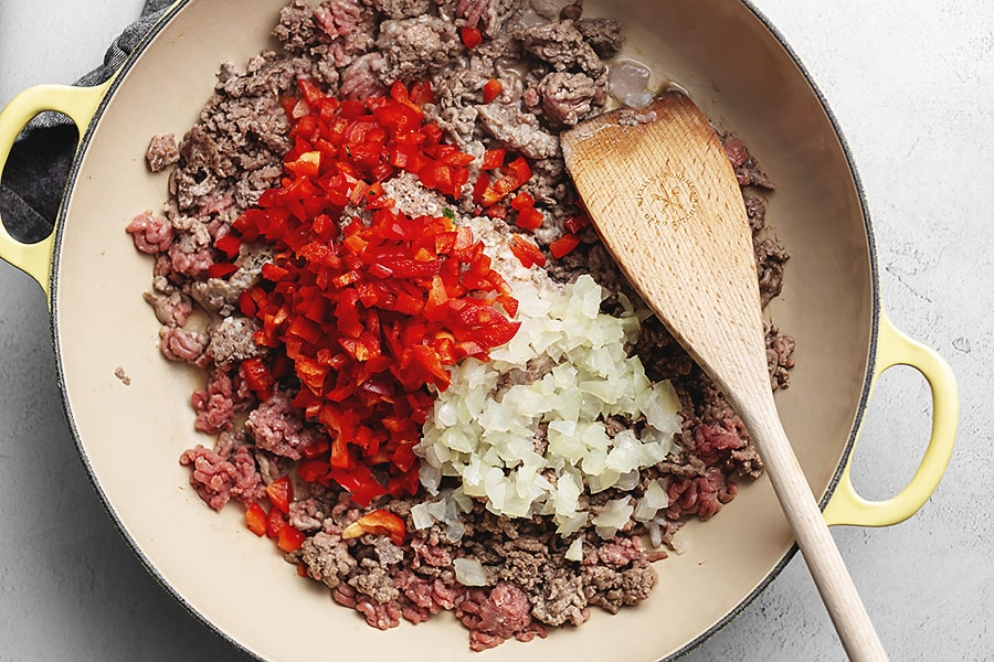 ground beef in a bowl with seasonings