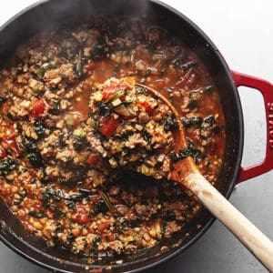 italian vegetable stew in a red pot