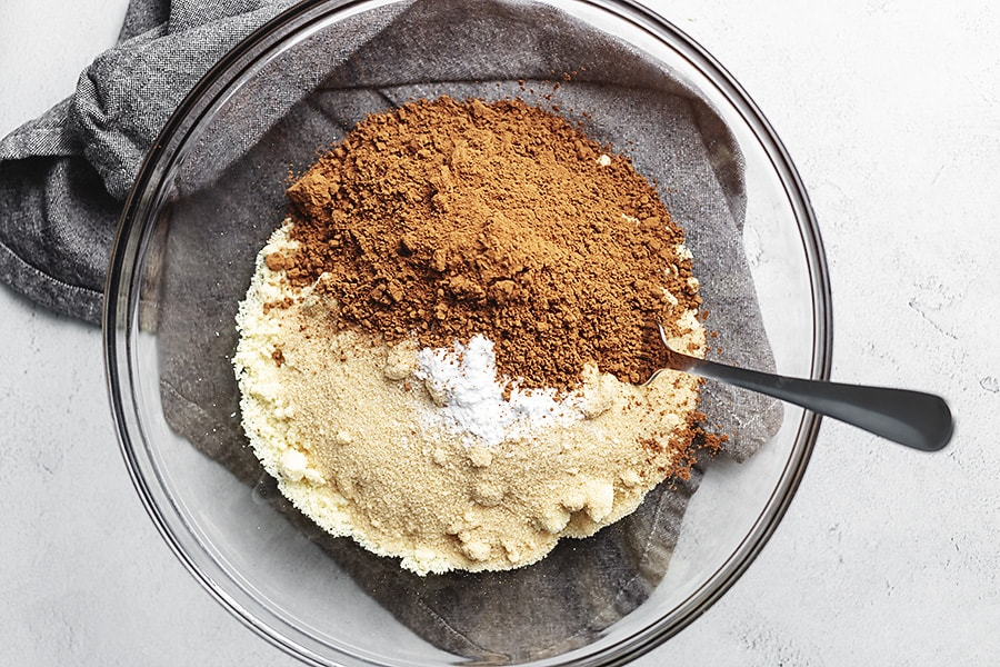keto chocolate cupcake ingredients in a glass bowl