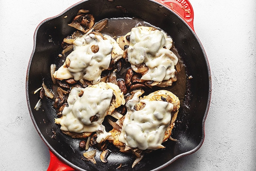 French onion smothered chicken in a skillet