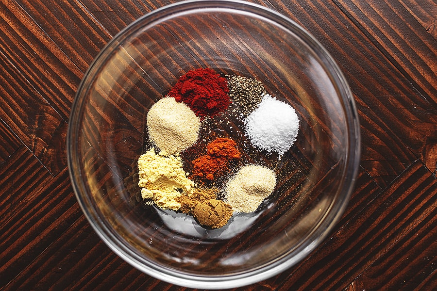 spices for bacon wrapped chicken thighs in a glass bowl