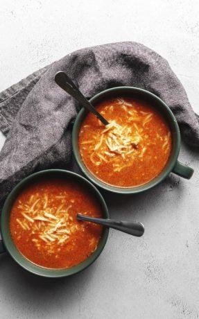 chicken enchilada soup in green bowls