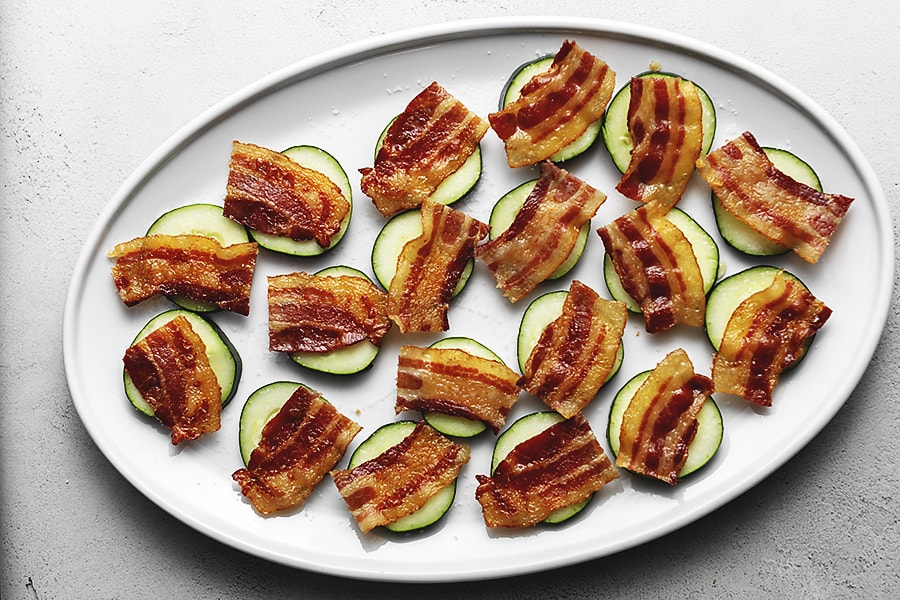 cucumber and bacon for keto shrimp guacamole bacon on a white platter