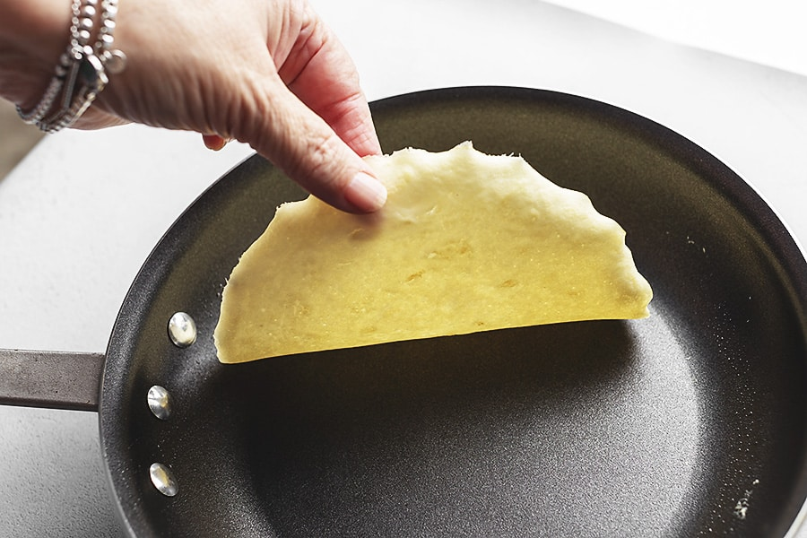 keto crepes being cooked in a skillet