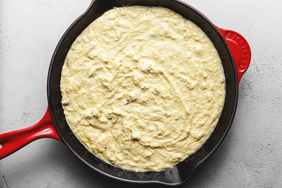 cornbread batter in a cast iron skillet