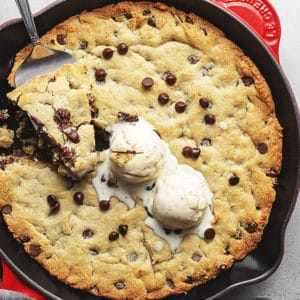 keto skillet chocolate chip cookie fresh out of the oven in a skillet