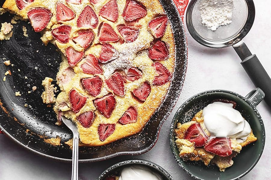 keto strawberry clafoutis in a cast iron skillet