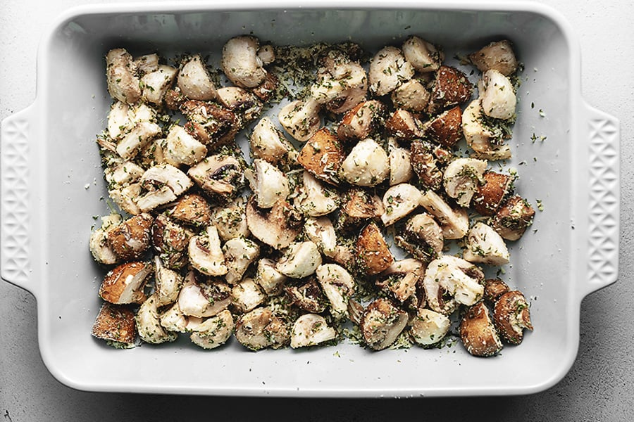 roasted garlic and thyme mushrooms in a casserole dish