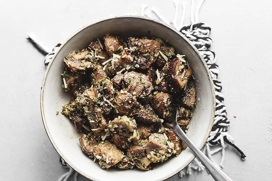 roasted garlic and thyme mushrooms in a while glass bowl