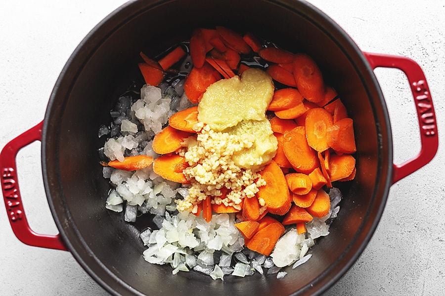 thai chicken ingredients in a dutch oven