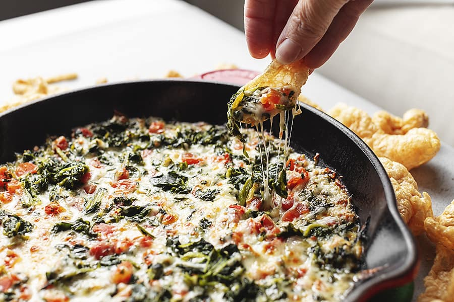 3 ingredient spinach dip in a cast iron skillet fresh out of the oven