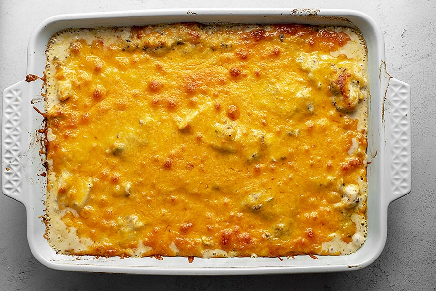 baked chicken spaghetti with squash baked in a casserole dish