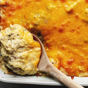 baked chicken spaghetti with squash in a while casserole dish