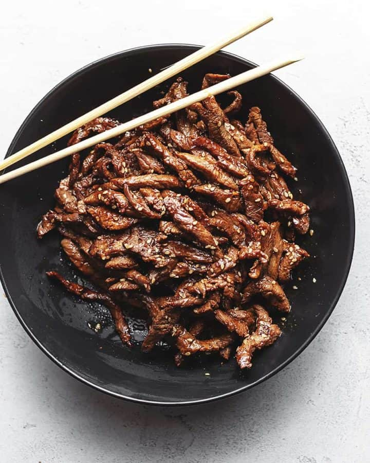 keto beef bulgogi in a black bowl with chopsticks