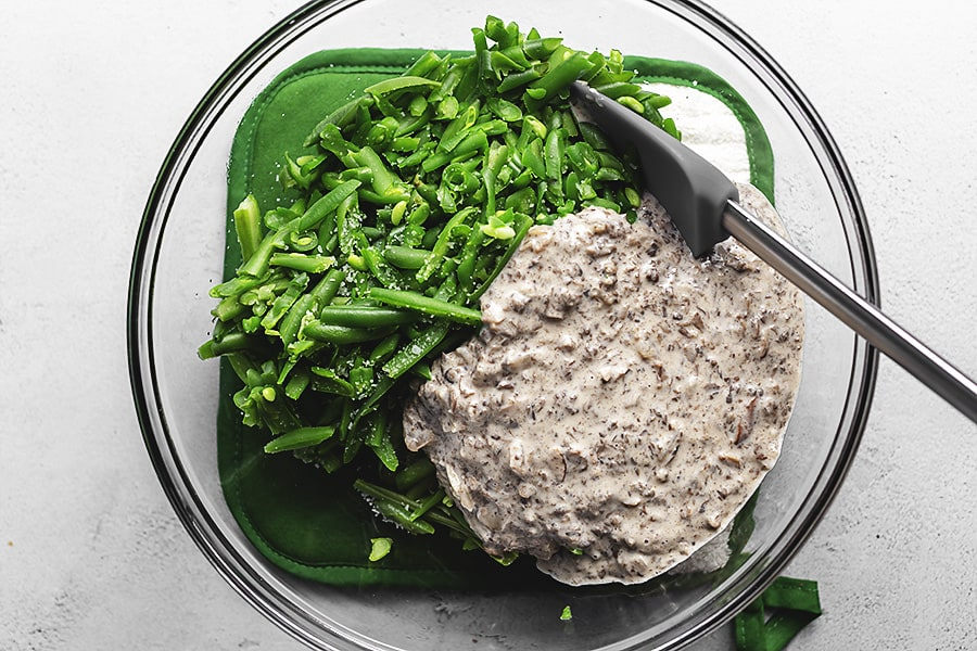 green beans and mushroom mixture in a glass bowl
