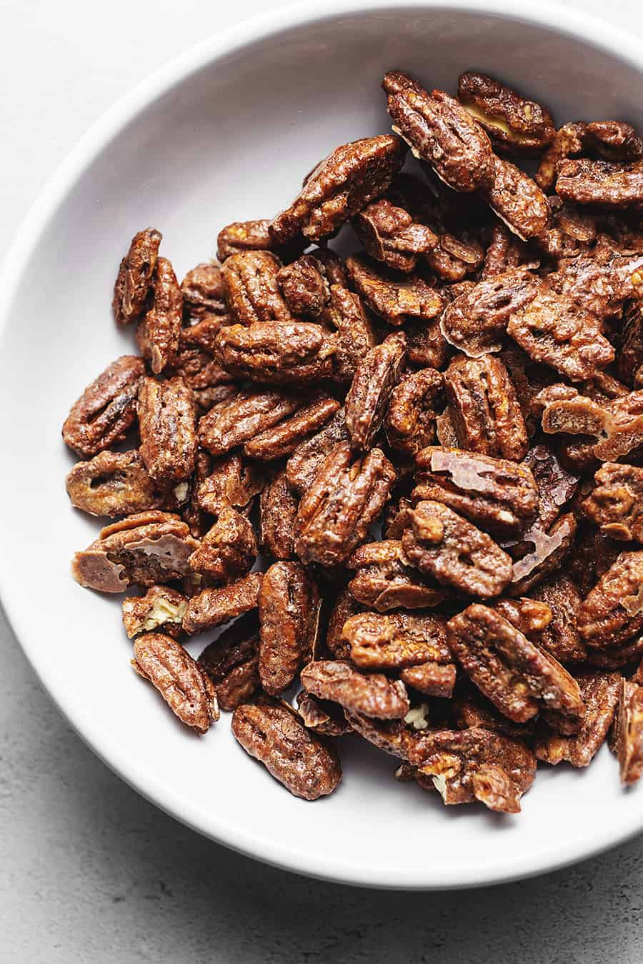 keto candied pecans in a white bowl
