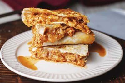 keto chicken enchilada quesadillas on a white plate