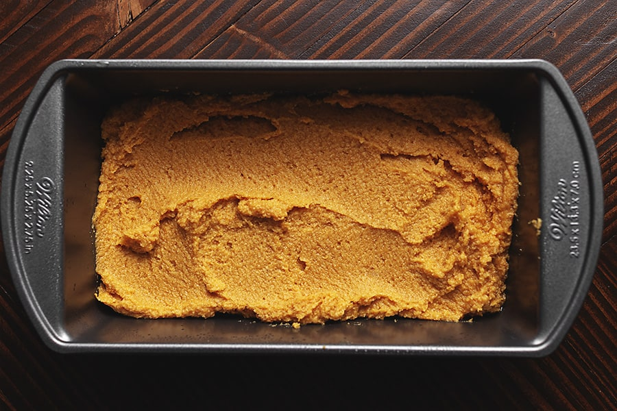 keto pumpkin bread in a greased loaf pan