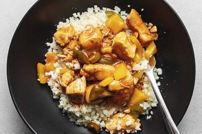 keto sweet and sour chicken over steam cauliflower rice