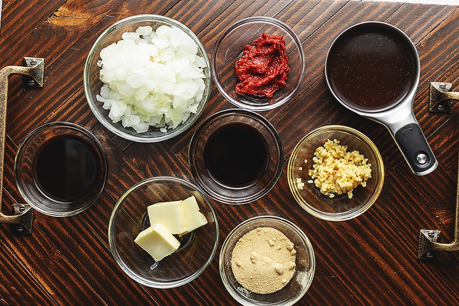 Ingredients for balsamic marinade in glass bowls