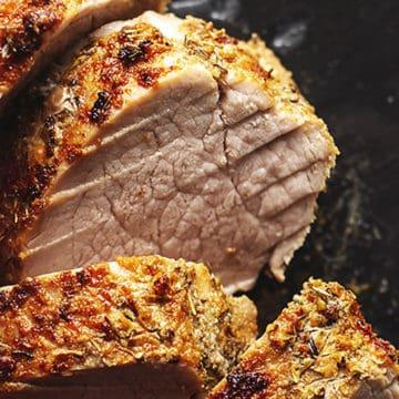 pork tenderloin sliced on a black background