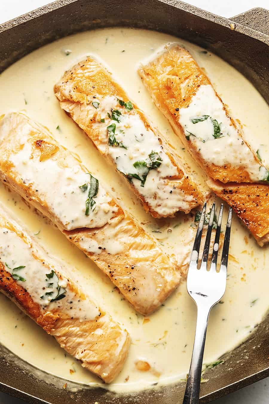 4 cooked salmon filets in a creamy sauce