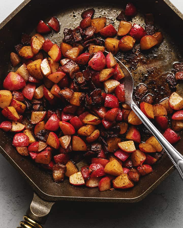 radishes with bacon in a cast iron skillet
