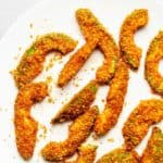 avocado fries cooked in the air fryer on a white plate