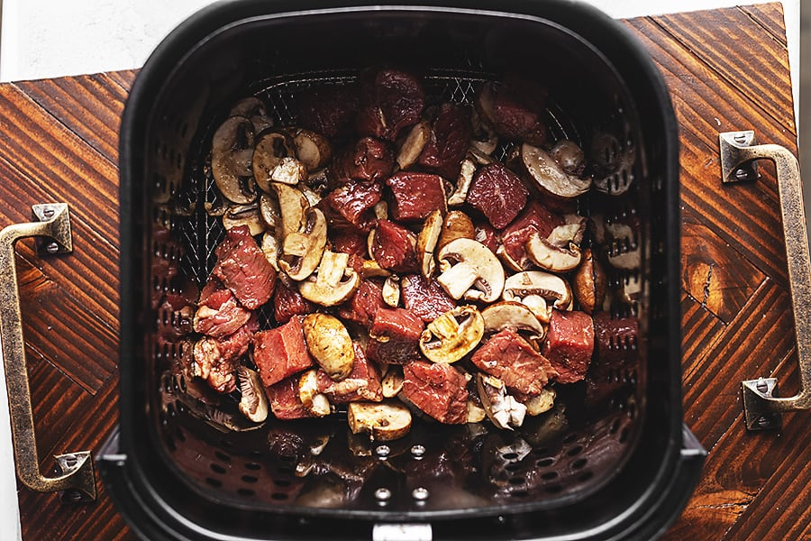 raw steak and mushrooms in the air fryer