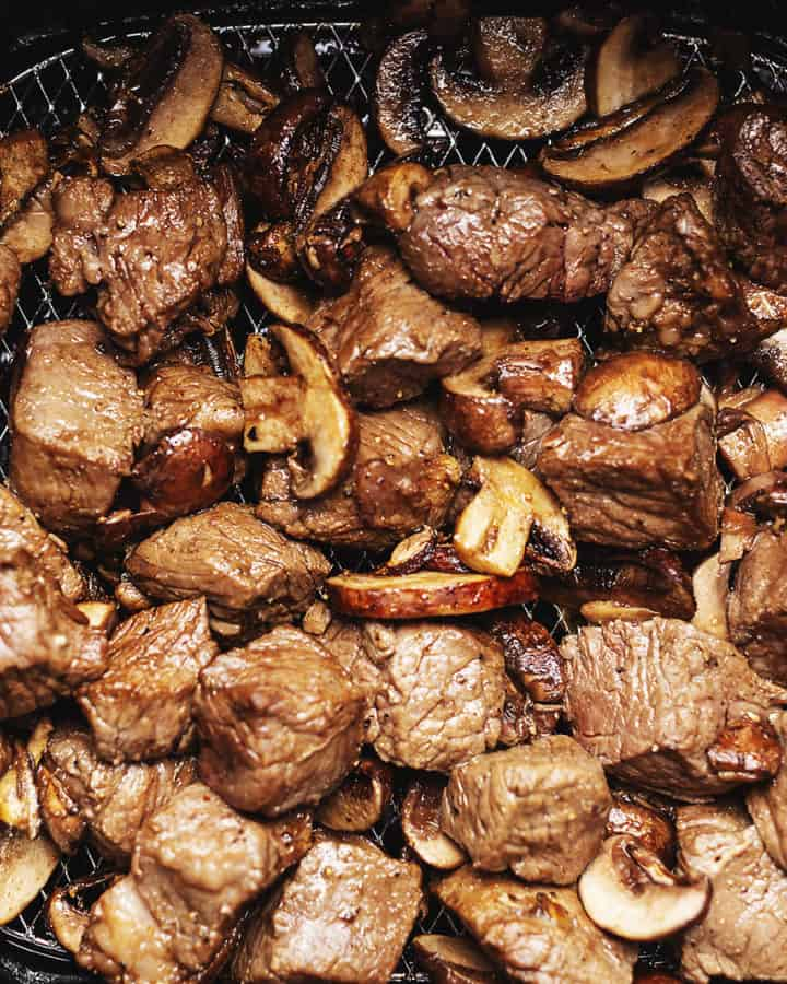 steak cubes and mushrooms in an air fryer