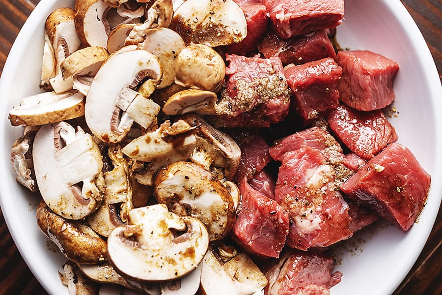 steak and mushrooms in a marinade.