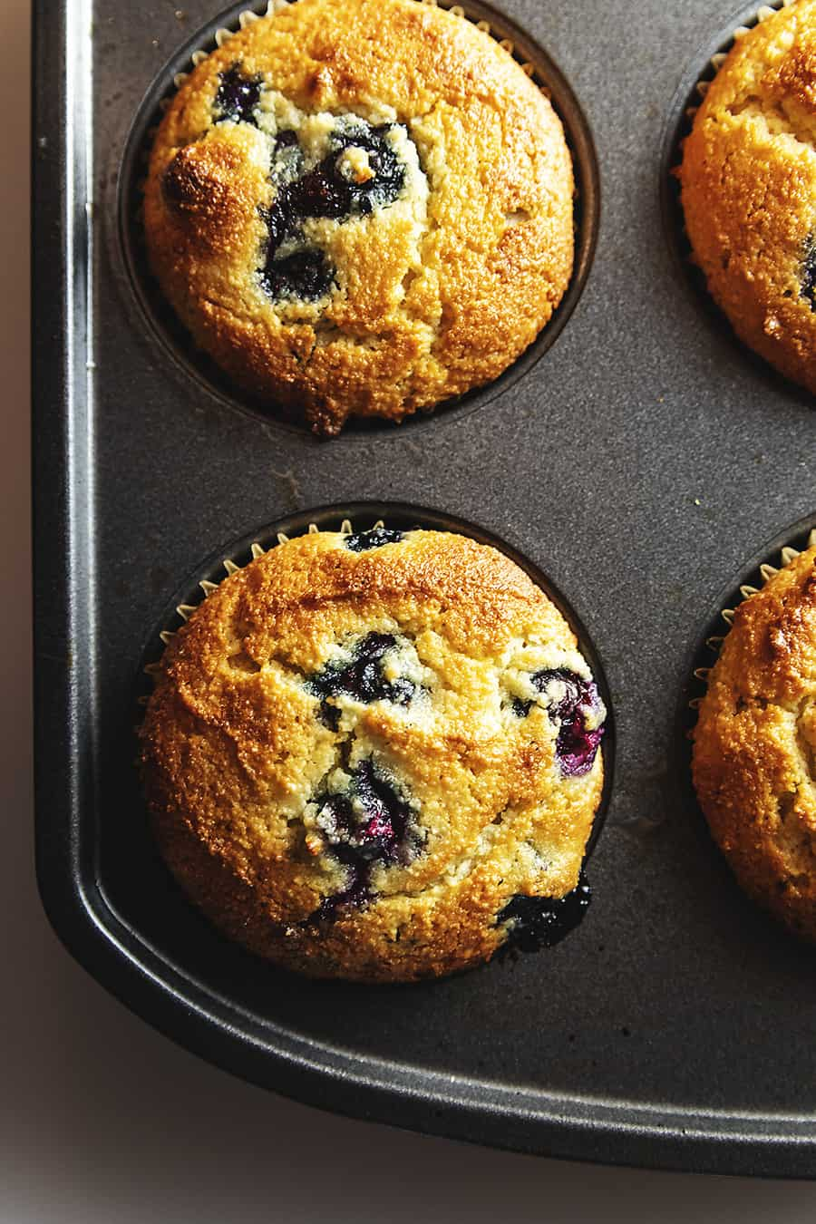 keto blueberry muffins in a muffin tin