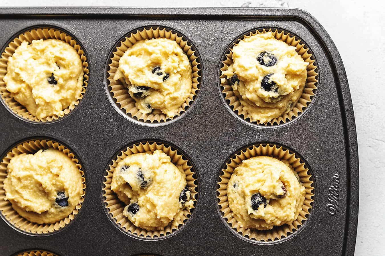 muffin batter in a cupcake tin